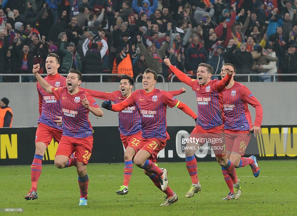 Steaua Bucharest celebrates the qualification against Ajax Amsterdam during UEFA Europa League Round of 32 football match in Bucharest February 21, 2013.