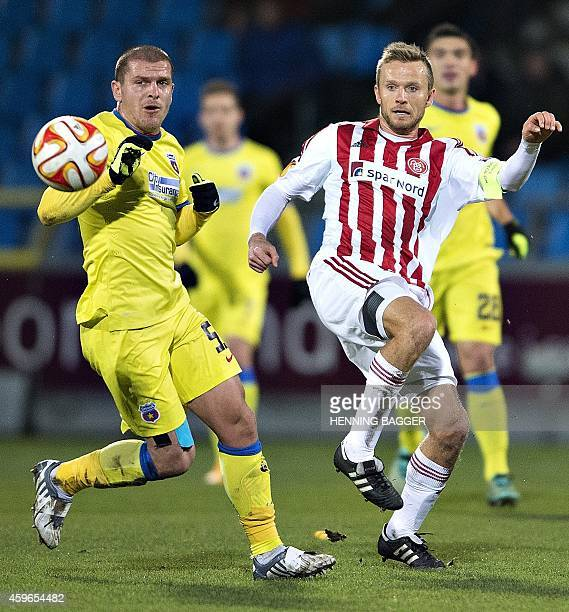 Steaua Bucharest's midfielder Alexandru Bourceanu and AaB's midfielder Rasmus Wurtz vie for the ball during the UEFA Europa League Group J football...