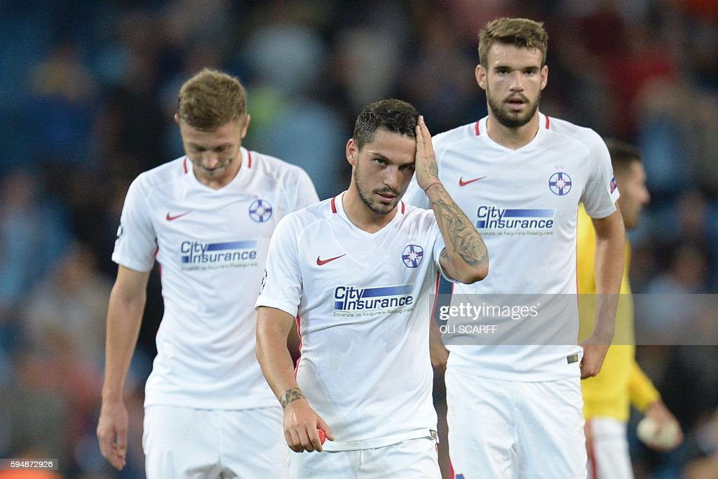 Steaua Bucharest's Romanian midfielder Nicolae Stanciu (C) reacts with his teammates at the end of the UEFA Champions league second leg play-off football match between Manchester City and Steaua Bucharest at the Etihad Stadium in Manchester, north west England on August 24, 2016. / AFP / OLI
