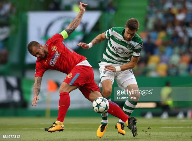 Steaua Bucuresti FC forward Denis Alibec from Romania tackled by Sporting CP defender Sebastian Coates from Uruguay during the UEFA Champions League...