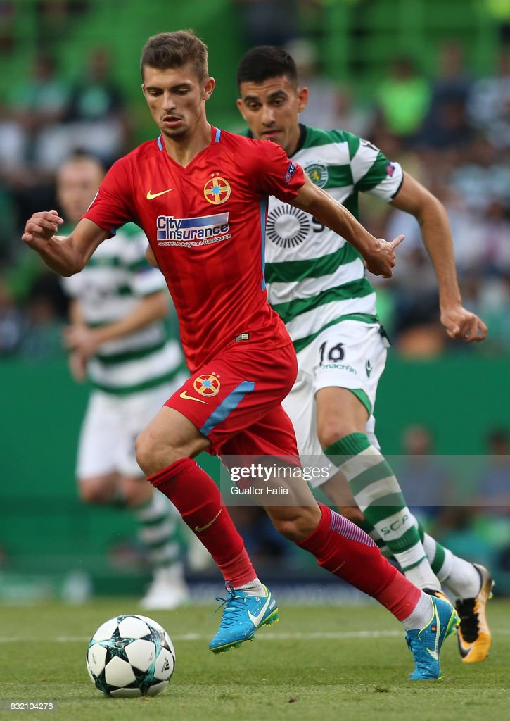 Steaua Bucuresti FC forward Florin Tanase from Romania with Sporting CP midfielder Rodrigo Battaglia from Argentina in action during the UEFA Champions League Qualifying Play-Offs Round - First Leg match between Sporting Clube de Portugal and Steaua Bucuresti FC at Estadio Jose Alvalade on August 15, 2017 in Lisbon, Portugal.