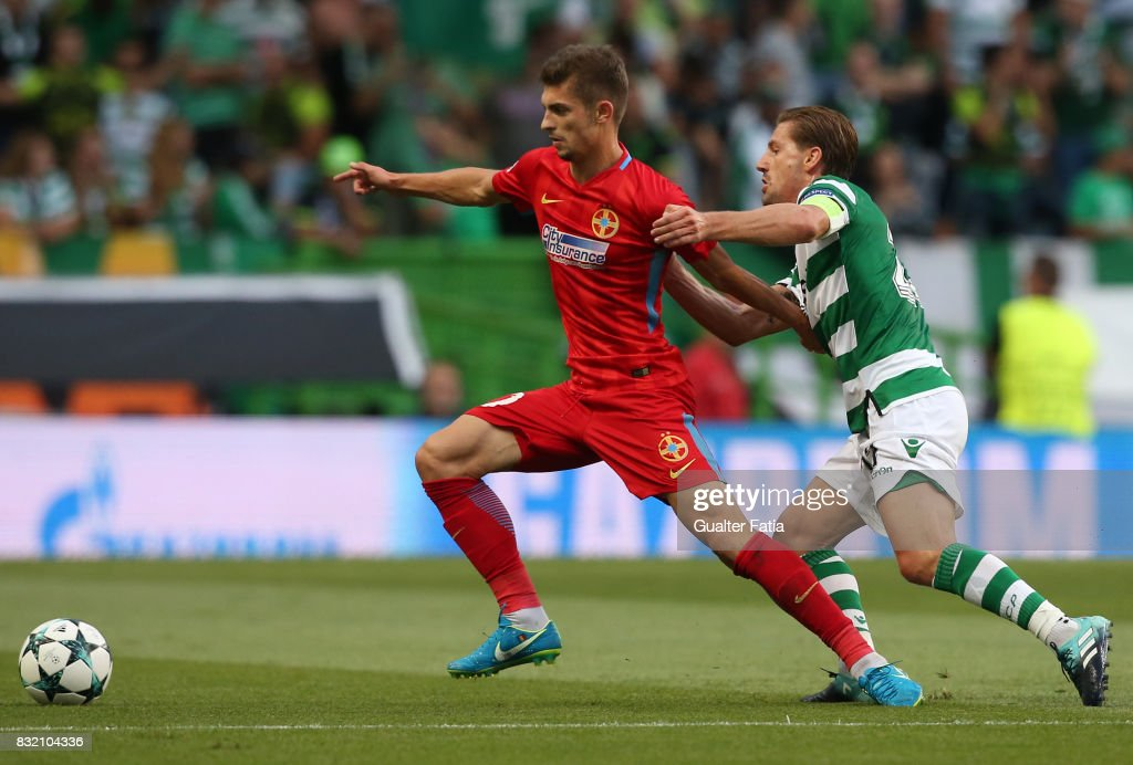 Steaua Bucuresti FC forward Florin Tanase from Romania with Sporting CP midfielder Adrien Silva from Portugal in action during the UEFA Champions League Qualifying Play-Offs Round - First Leg match between Sporting Clube de Portugal and Steaua Bucuresti FC at Estadio Jose Alvalade on August 15, 2017 in Lisbon, Portugal.
