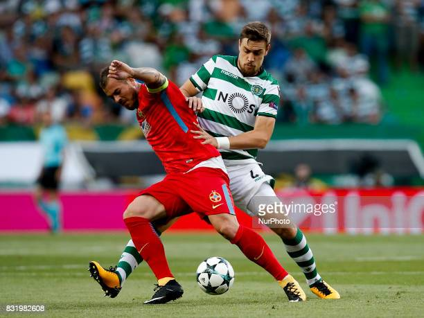 Steaua's forward Denis Alibec vies for the ball with Sporting's defender Sebastian Coates during Champions League 2017/18 first playoff round match...