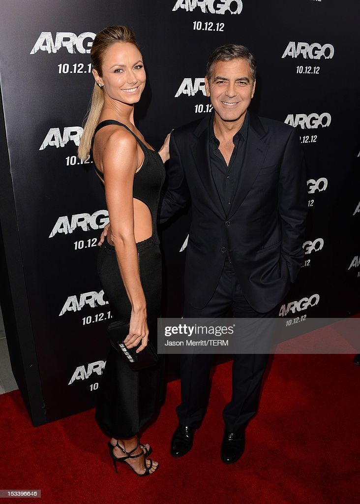 Stecy Keibler (L) and actor <a gi-track='captionPersonalityLinkClicked' href=/galleries/search?phrase=George+Clooney&family=editorial&specificpeople=202529 ng-click='$event.stopPropagation()'>George Clooney</a> arrive at the premiere of Warner Bros. Pictures' 'Argo' at AMPAS Samuel Goldwyn Theater on October 4, 2012 in Beverly Hills, California.