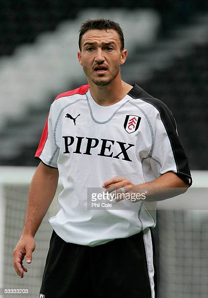 Steed Malbranque of Fulham gets instuctions from manager Chris Coleman during the friendly match between Fulham and Panionios at Craven Cottage on...