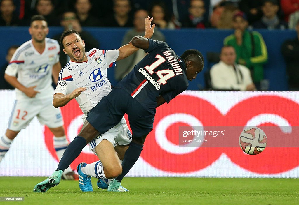 <a gi-track='captionPersonalityLinkClicked' href=/galleries/search?phrase=Steed+Malbranque&family=editorial&specificpeople=206647 ng-click='$event.stopPropagation()'>Steed Malbranque</a> of Lyon and <a gi-track='captionPersonalityLinkClicked' href=/galleries/search?phrase=Blaise+Matuidi&family=editorial&specificpeople=801779 ng-click='$event.stopPropagation()'>Blaise Matuidi</a> of PSG in action during the French Ligue 1 match between Paris Saint-Germain FC and Olympique Lyonnais OL at Parc des Princes stadium on September 21, 2014 in Paris, France.