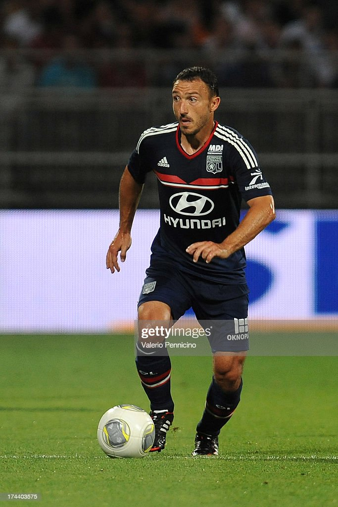 <a gi-track='captionPersonalityLinkClicked' href=/galleries/search?phrase=Steed+Malbranque&family=editorial&specificpeople=206647 ng-click='$event.stopPropagation()'>Steed Malbranque</a> of Olympique Lyonnais in action during the Pre Season match between Olympique Lyonnais and Real Madrid at Gerland Stadium on July 24, 2013 in Lyon, France.