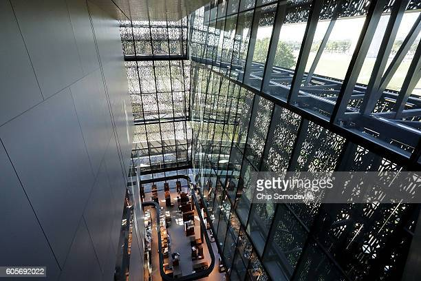 Steel and glass create patterns and reflections inside the Smithsonian's National Museum of African American History and Culture during the press...