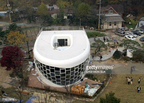 A steel and glass toiletshaped house is seen in Suwon 40 kilometers south of Seoul 09 November 2007 The house owned by South Korean sanitation...