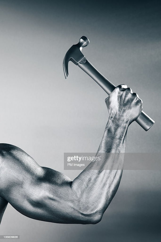 Steel Arm and Hammer : Stock Photo