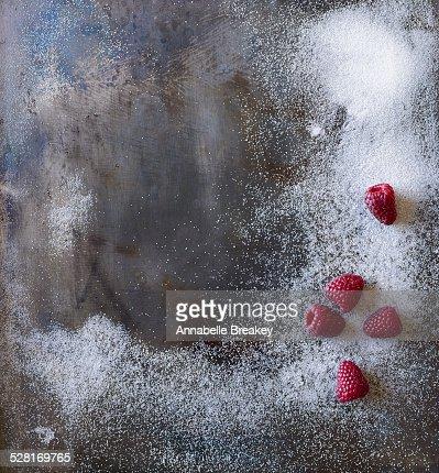 Steel Background Surface with Sugar & Raspberries