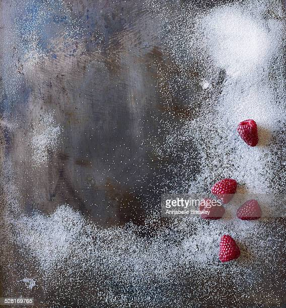 Steel Background Surface with Sugar & Raspberries