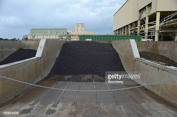 Steel balls used for crushing copper ore in ball mills sit in a concrete pit at the processing plant of Rio Tinto Group's Northparkes copper and gold...