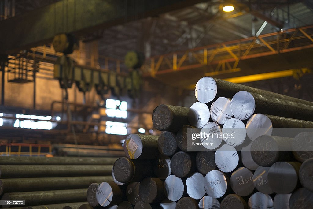 Steel billets lie in a stack before being made into pipes at the Interpipe LLC seamless pipe factory in Nikopol, Ukraine, on Wednesday, Jan. 30, 2013. Ukraine's Interpipe Group, owned by billionaire Victor Pinchuk, opened a $700 million electric steel mill in Dnipropetrovsk with an annual output capacity of 1.32 million tons of steel for its seamless pipe production. Photographer: Vincent Mundy/Bloomberg via Getty Images