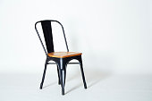 Steel chair with light wood on a white background