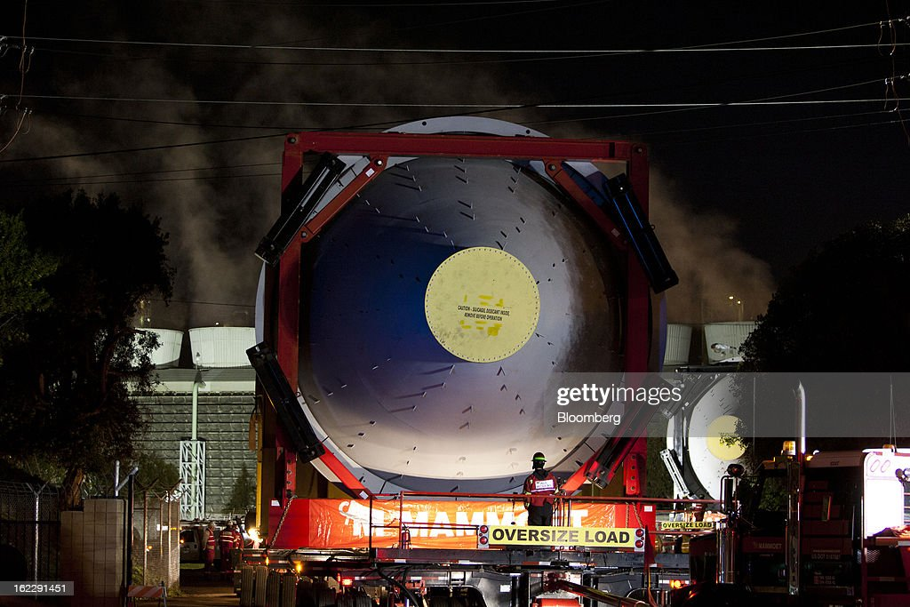 A steel coke drum on a trailer manufactured by Mammoet Salvage BV arrives at the entrance to Chevron Corp.'s refinery in El Segundo, California, U.S., on Wednesday, Feb. 20, 2013. The drum, which measures over 100 feet long and weighs over 500,000 pounds, is one of six scheduled to be delivered to the refinery. Photographer: Patrick Fallon/Bloomberg via Getty Images