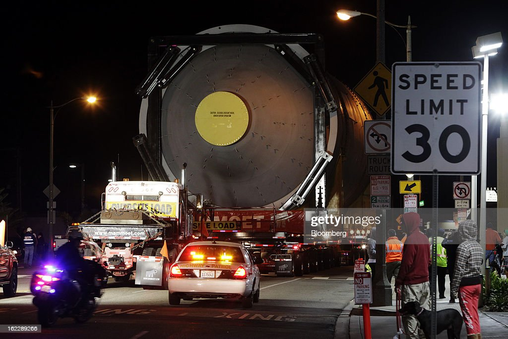 A steel coke drum travels on a trailer manufactured by Mammoet Salvage BV between Redondo Beach and El Segundo, California, U.S., on Wednesday, Feb. 20, 2013. The drum, which measures over 100 feet long and weighs over 500,000 pounds, is one of six scheduled to be delivered to Chevron Corp.'s refinery in El Segundo. Photographer: Patrick Fallon/Bloomberg via Getty Images