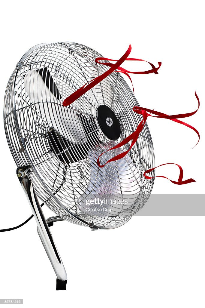 Steel electric floor fan with red ribbons flying : Stock Photo