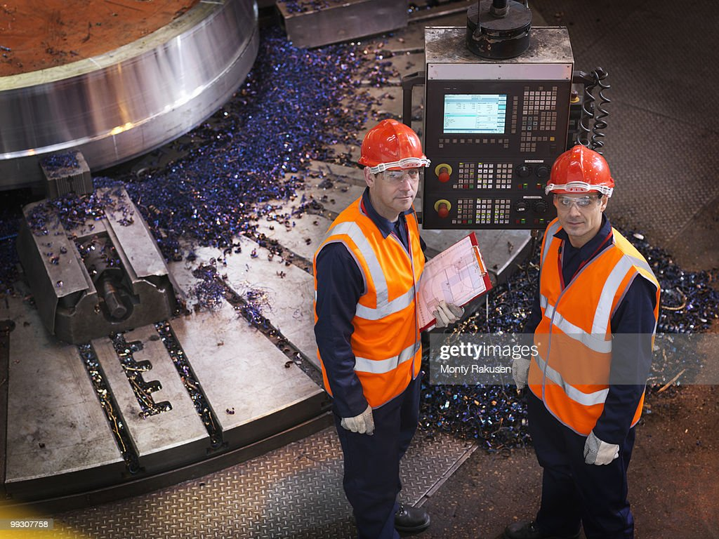 Steel Engineers With Lathe : Stock Photo