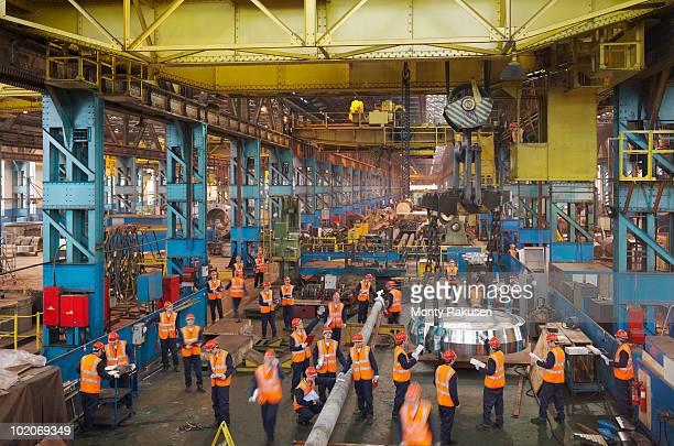 Steel Engineers Working In Plant