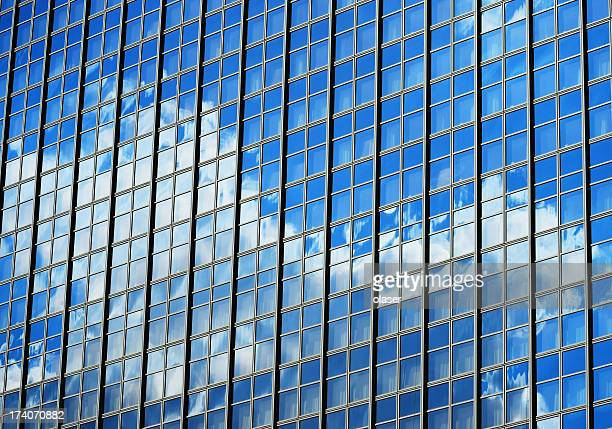 Steel / glass finance building, clouds and blue sky