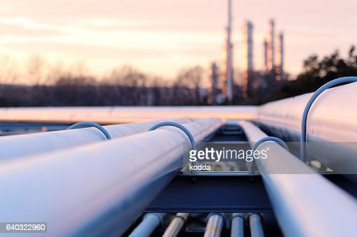 steel long pipes in crude oil factory during sunset : Stock-Foto