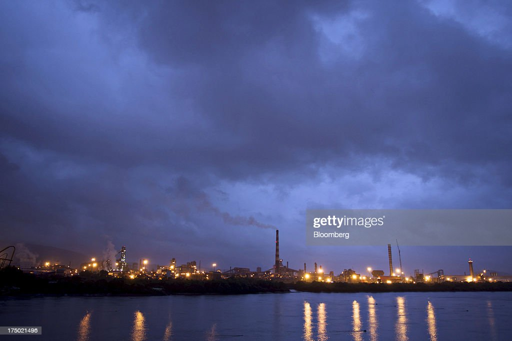 Steel Ltd. manufacturing facility stands illuminated at night in Dolvi, Maharashtra, India, on Friday, July 27, 2013. JSW Steel is scheduled to announce first-quarter earnings on July 31. Photographer: Adeel Halim/Bloomberg via Getty Images