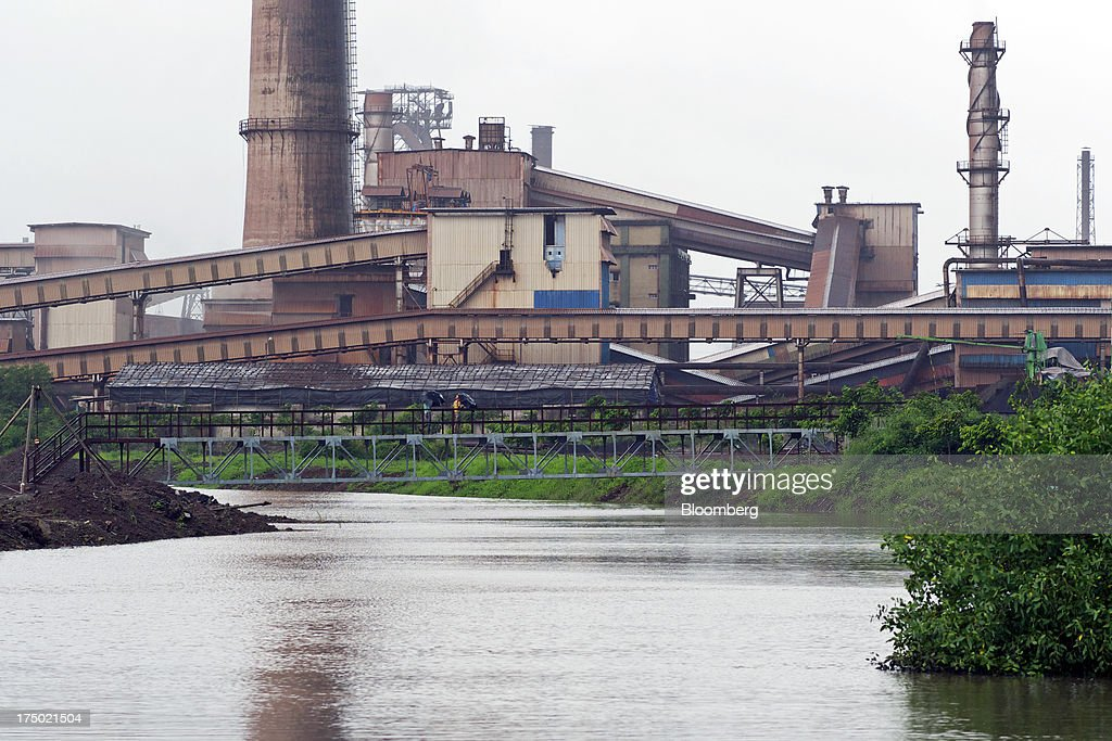 Steel Ltd. manufacturing facility stands on the banks of the Amba River in Dolvi, Maharashtra, India, on Friday, July 27, 2013. JSW Steel is scheduled to announce first-quarter earnings on July 31. Photographer: Adeel Halim/Bloomberg via Getty Images