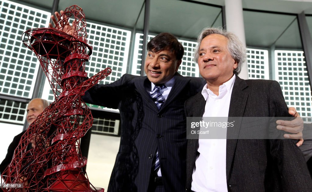 Steel magnate Lakshmi Mittal and artist Anish Kapoor pose with Kapoor's winning design for a visitor attraction to be placed in the 2012 Olympic Park...