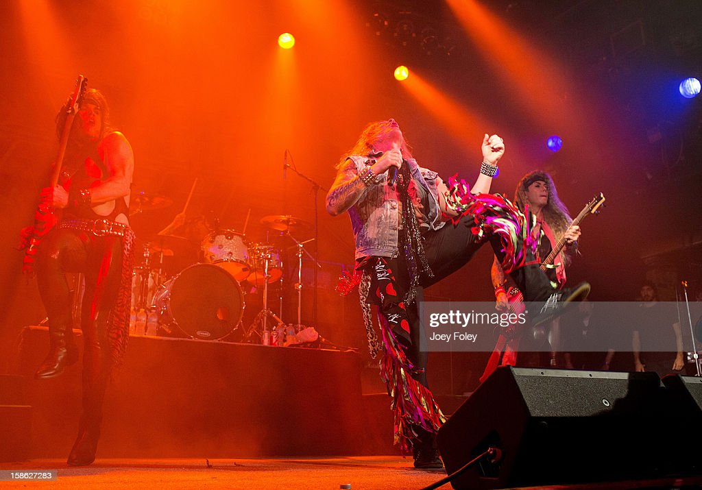 Steel Panther performs onstage in concert at Bogart's on December 15, 2012 in Cincinnati, Ohio.