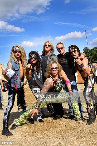 Steel Panther pose with Def Leppard Lexxi Foxxx Stix Zadinia Joe Elliott Michael Starr Phil Collen and Satchel backstage at Download Festival at...