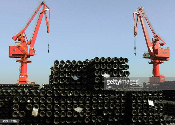 Steel pipes are seen at a port to be loaded onto ships for export to various countries in Lianyungang eastern China's Jiangsu province on December 1...