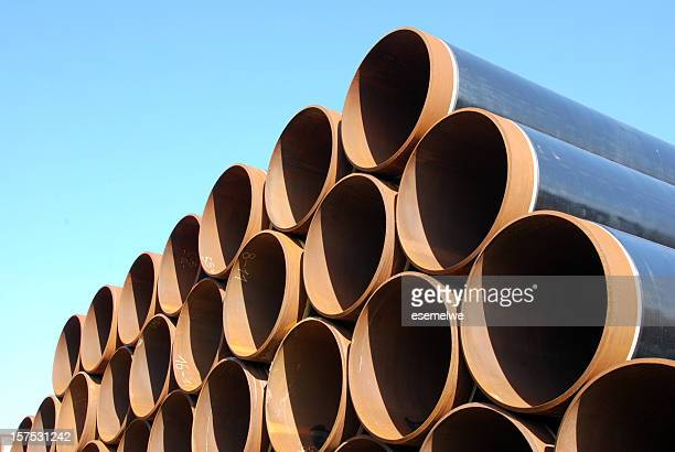 Steel pipes neatly stacked in rows