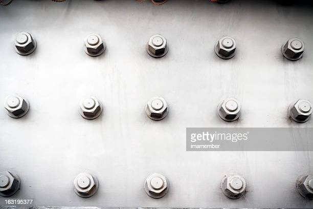 Steel plate with bolts and nuts, vignette