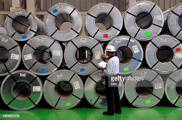 Steel rolls kept in godown at the POSCO India Pune Processing Center Pvt Ltd on January 24 2013 in MIDC Talegaon outskirts of Pune India