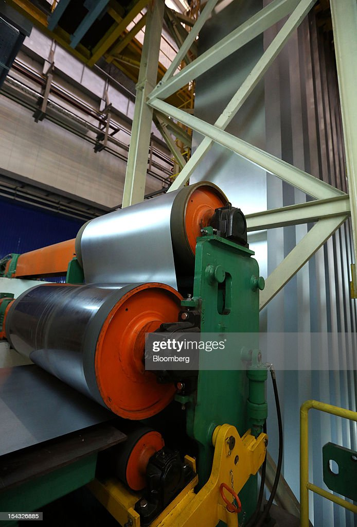 Steel sheets pass through a rolled steel module at the OAO Novolipetsk Steel plant, also known as NLMK, in Lipetsk, Russia, on Wednesday, Oct. 17, 2012. OAO Novolipetsk Steel, controlled by billionaire Vladimir Lisin, became Russia's largest steelmaker by output after boosting production by 24 percent. Photographer: Andrey Rudakov/Bloomberg via Getty Images