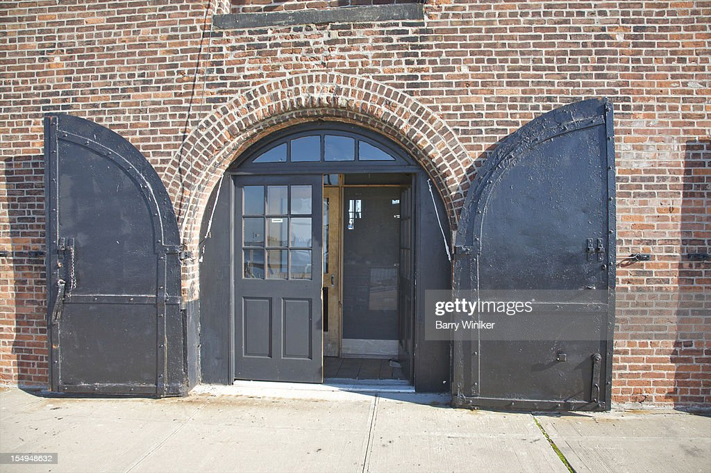 Steel shutters in front of arched doorway. : Stock Photo