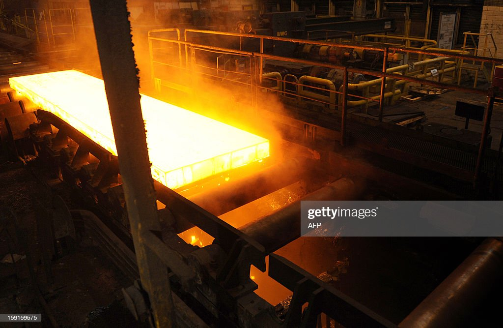 A steel slab is pictured is the hot mill train, on January 9, 2013 in Florange, eastern France. ArcelorMittal, run by steel tycoon Lakshmi Mittal, had said it will shut down two furnaces at Florange that are no longer used if a buyer for them cannot be found.