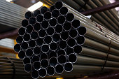 Steel tubing sits stacked on shelves in the tube mill at the manufacturing facility of Uttam Galva Steels Ltd the Indian unit of ArcelorMittal in...