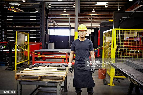 Steel worker wearing hard hat and safety glasses