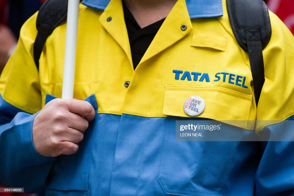 A steel worker wearing Tata Steel overalls takes part in a protest march through central London on May 25, 2016. Britain's business minister Sajid Javid met Tata Steel bosses in Mumbai ahead of a crunch board meeting on Wednesday expected to discuss potential buyers for its loss-making UK assets. Tata Steel, Britain's biggest steel employer, announced in March that it planned to sell its Port Talbot plant in Wales and other assets, putting 15,000 jobs at risk. / AFP / LEON