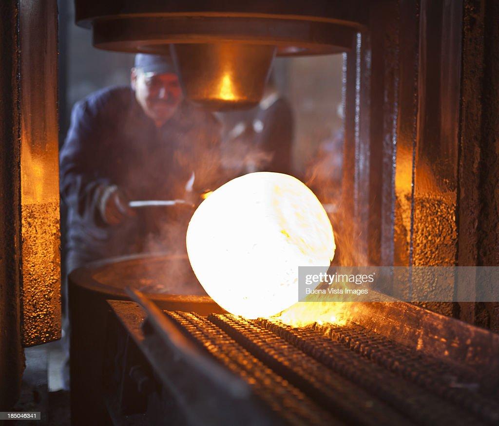 steel  worker with heated metal