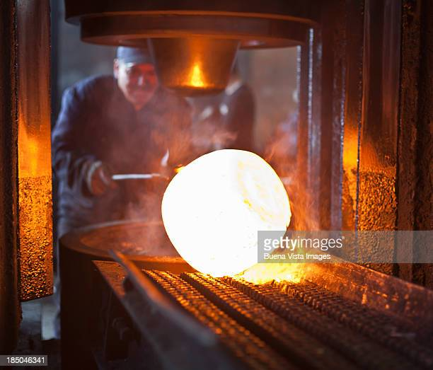 steel  worker with heated metal