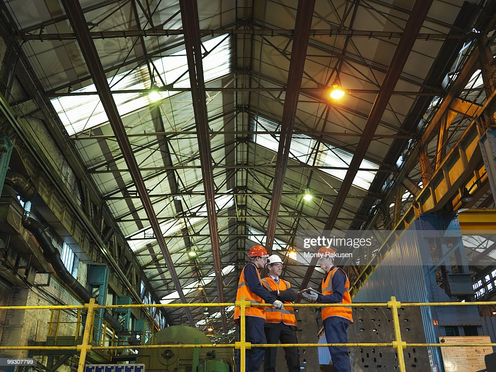 Steel Workers And Engineer In Factory : Stock Photo