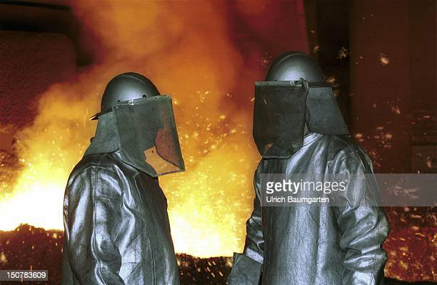 Steel workers at the blast furnace tap of the Salzgitter AG