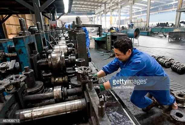 Steel workers in a steel factory on June 27 2009 in Huashi near Jiangyin Jiangsu province China
