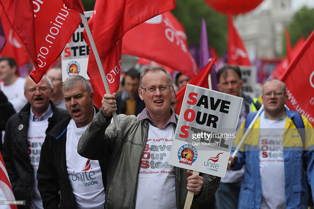 Steel workers march through Whitehall on May 25, 2016 in London, England. Steelworkers marched through Westminster today to highlight the crisis in the steel industy. A shortlist of bidders is currently being drawn up for the UK assets of Tata Steel.