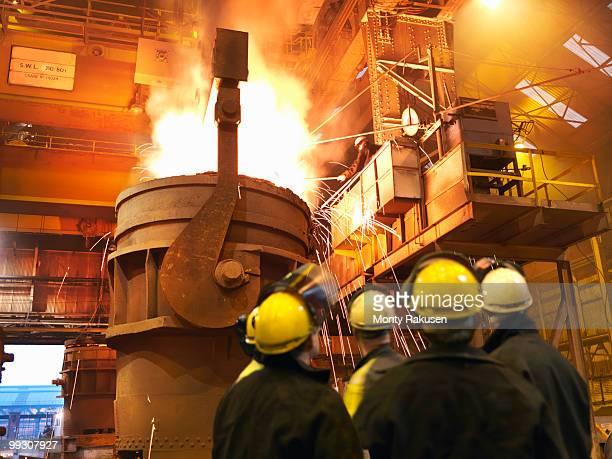 Steel Workers Pouring Molten Steel