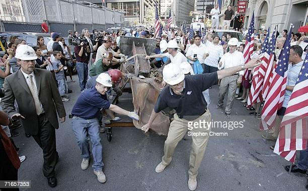 Steel workers roll a steel beam recovered and removed from the World Trade Center site after the terrorist attacks of Sept11 2001 down Liberty Street...
