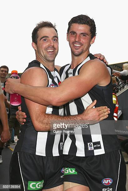 Steele Sidebottom and Scott Pendlebury of the Magpies celebrates winning the round nine AFL match between the Collingwood Magpies and the Carlton...